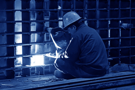 tangshan city: TANGSHAN CITY - JUNE 20: Worker welding parts in the production workshop, on June 20, 2014, Tangshan city, Hebei Province, China