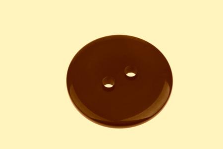 matiere plastique: Bouton en mati�re plastique sur un fond blanc Banque d'images