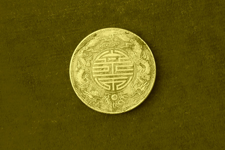 TAGNSHAN CITY - AUGUST 31: Labeled Guangxu yuan treasure ping heavy one two made in guangdong province words on the silver dollar, in an exhibition hall, on august 31, 2013, tangshan city, hebei province, China.   Editorial