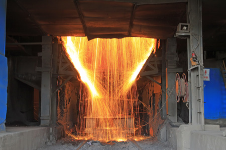 crucible: TANGSHAN - JUNE 20: converter dumping steel slag in iron and steel co., on June 20, 2014, Tangshan city, Hebei Province, China