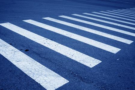 zebra crossing on asphalt pavement