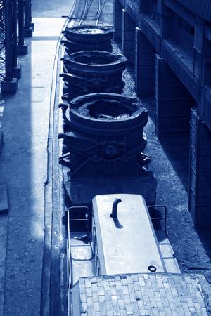 crucible: TANGSHAN - JUNE 14: Transportation molten iron crucible train, on June 14, 2014, Tangshan city, Hebei Province, China
