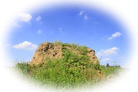 loess: loess heap under the blue sky and white cloud, closeup of photo