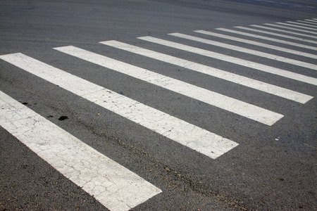 zebra crossing on asphalt pavement