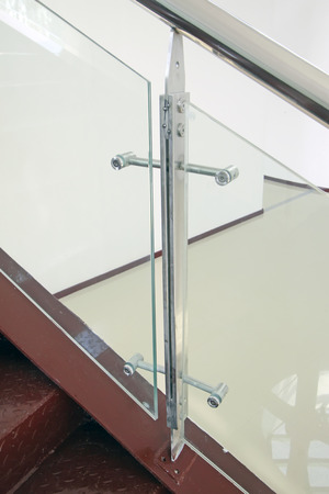 Tempered glass and stainless steel fasteners, closeup of photo Standard-Bild