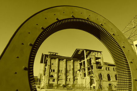 generalized: TANGSHAN - NOVEMBER 4: The gears and abandoned factories in the Qixin cement plant on november 4, 2013, tangshan city, hebei province, China. Stock Photo