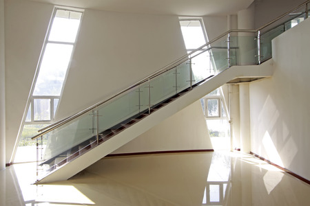 glass and stainless steel handrails in an art gallery
