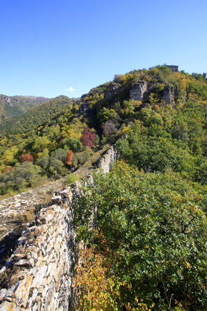 Great Wall in the mountains in autumn, China photo
