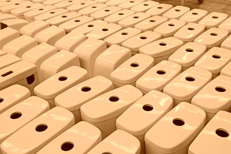 closestool: LUANNAN COUNTY - JANUARY 5: The neat rows of ceramic closestool products assemblies in a warehouse, in the ZhongTong Ceramics Co., Ltd. January 5, 2014, Luannan county, Hebei Province, China. Stock Photo