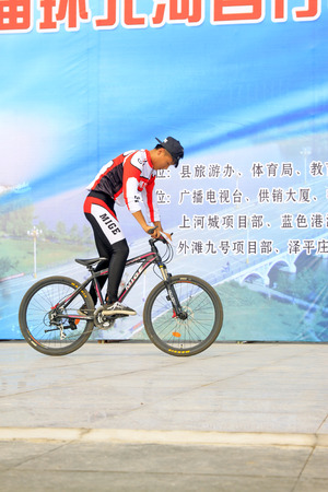 special effects: LUANNAN - AUGUST 2: bicycle special effects performance in a square on august 2, 2014, Luannan county, Hebei Province, China