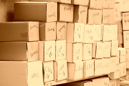 disorderly: goods paper boxes piled up together in a shop Editorial