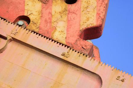 crank: teeth scale on beam pumping unit crank pulley, closeup of photo