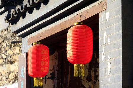 restore ancient ways: BEIJING - OCTOBER 5: Yanjing beer advertising lanterns in the CuanDiXia village, on october 5, 2014, Beijing, China
