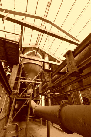 metal pipes: rusty metal pipes, in a dirty abandoned workshop