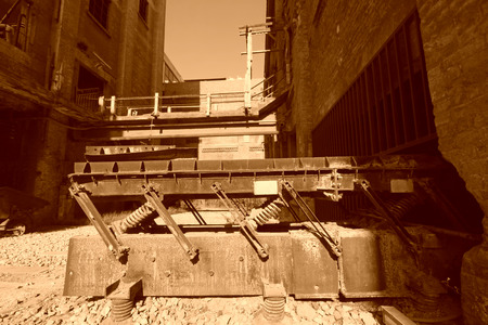 disorderly: abandoned mechanical equipment in the factory, closeup of photo