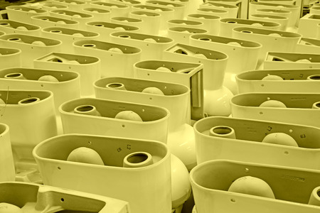 LUANNAN COUNTY - JANUARY 5: The neat rows of ceramic closestool products assemblies in a warehouse, in the ZhongTong Ceramics Co., Ltd. January 5, 2014, Luannan county, Hebei Province, China. Stock Photo