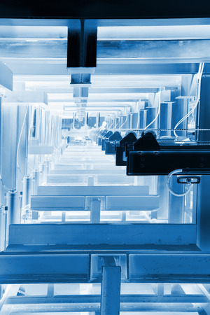 solid wire: transmission device in the production line in a factory, closeup of photo Stock Photo