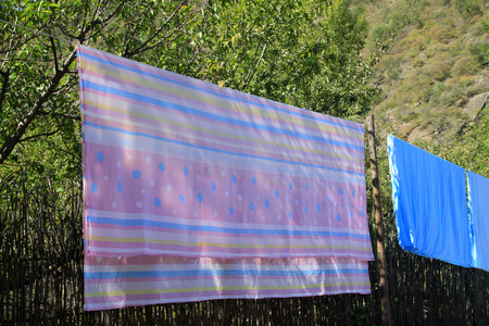 drying sheets in the outdoor, closeup of photo