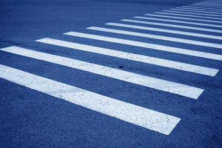 zebra crossing: zebra crossing on asphalt pavement
