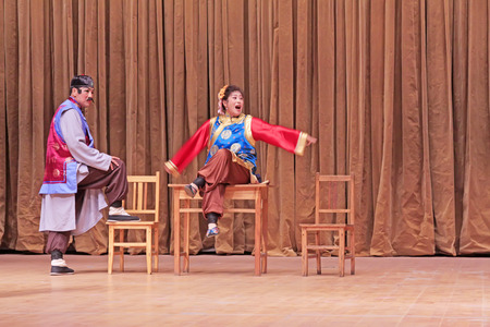 stage props: LUANNAN COUNTY - SEPTEMBER 22: Ancient costume PingJu  Yang Sanjie Filed a lawsuit  still, on September 22, 2014, Luannan county, Hebei Province, China Editorial