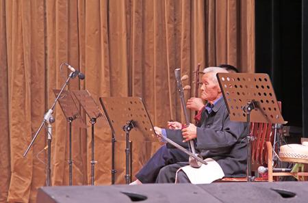 accompaniment: LUANNAN COUNTY - SEPTEMBER 22: Accompaniment band on stage, on September 22, 2014, Luannan county, Hebei Province, China