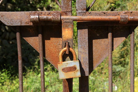 iron oxide: Rusty iron oxide and locks, closeup of photo Stock Photo