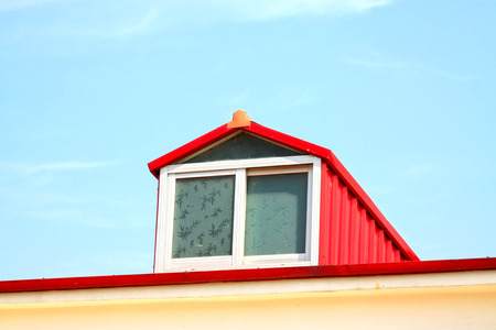 attic: Red attic window, closeup of photo