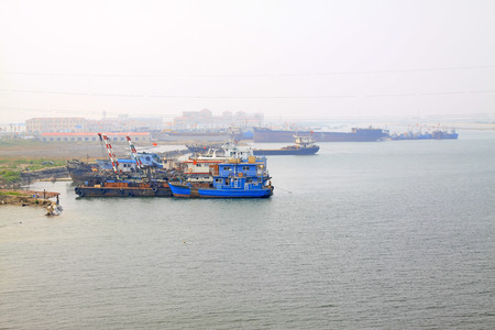 vision repair: LUANNAN COUNTY - AUGUST 23:ships waiting in port wharf, on august 23, 2014, Luannan County, Hebei Province, China
