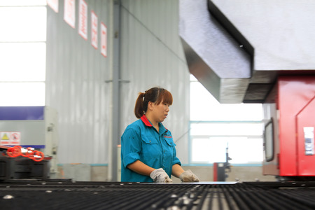 mechanization: LUANNAN COUNTY - AUGUST 23: workers busy on the production line, on august 23, 2014, Luannan County, Hebei Province, China