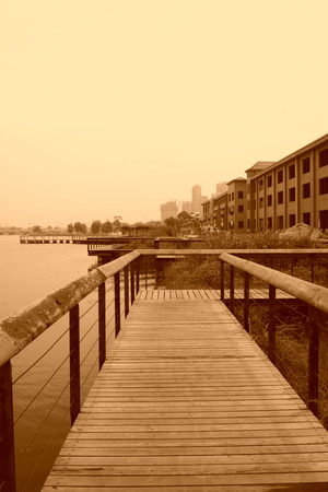 park wooden corridor and unfinished buildings, closeup of photo