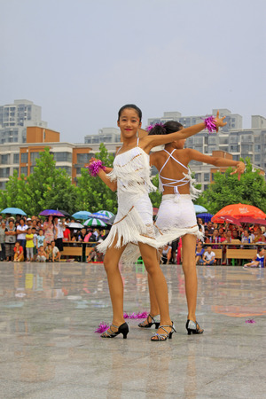 ms: LUANNAN COUNTY - AUGUST 10: Latin dance performances in the open air, on august 10, 2014, Luannan County, Hebei Province, China. Editorial