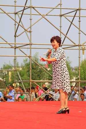 LUANNAN COUNTY - AUGUST 9: Singing performances in the open air, on august 9, 2014, Luannan County, Hebei Province, China.