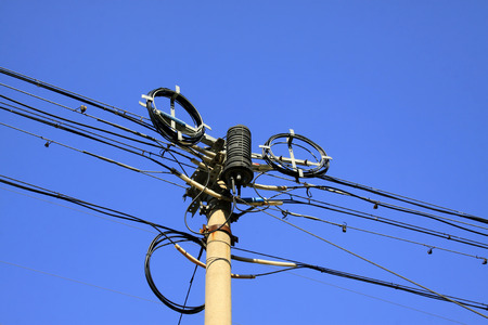 disorderly: Power facilities under the blue sky, closeup of photo