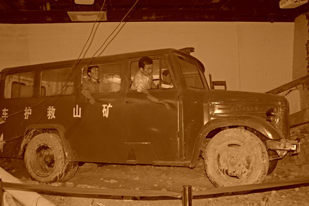 the exhibition hall: TANGSHAN CITY - NOVEMBER 16: The mine rescue car in the exhibition hall, in the Tangshan earthquake ruins park, on november 16, 2013, tangshan city, hebei province, China. Editorial