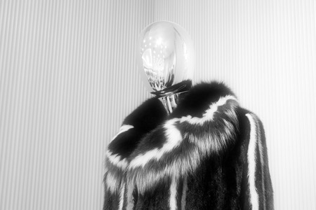 alloy: alloy mannequin wearing black fur clothing, closeup photo