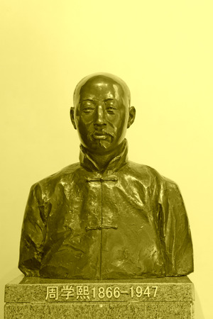 lifelike: TANGSHAN - NOVEMBER 16: The ZhouXuexi sculpture in the Kailuan museum, he was the northern states of the luanhe river officer ore company founder, november 16, 2013, tangshan, hebei province, china.
