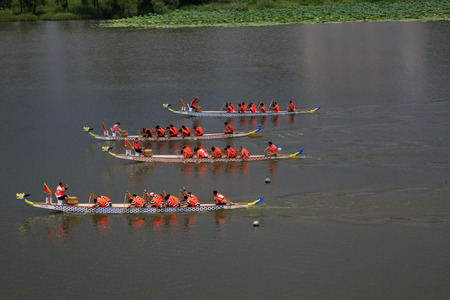 river county: LUANNAN COUNTY - AUGUST 9: dragon boat race scene in the river on august 9, 2014, Luannan County, Hebei Province, China. Editorial