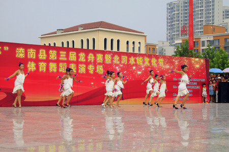 latin dance: LUANNAN COUNTY - AUGUST 10: Children Latin dance performances in the open air, on august 10, 2014, Luannan County, Hebei Province, China. Editorial