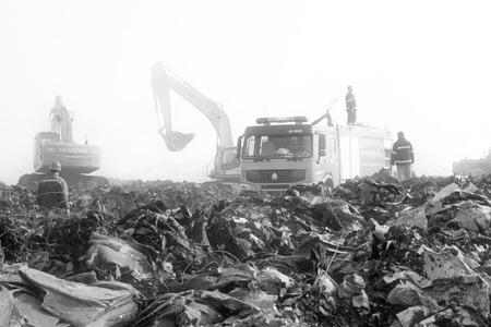 cluttered: TANGSHAN - NOVEMBER 20: The Fire fighting vehicles and cluttered environment after the fire, November 20, 2013, tangshan city, hebei province, China. Editorial