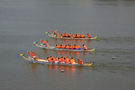 LUANNAN COUNTY - AUGUST 9: dragon boat race scene in the river on august 9, 2014, Luannan County, Hebei Province, China. Editorial