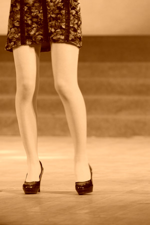 high heeled shoes: female legs wearing high heeled shoes on the stage Stock Photo