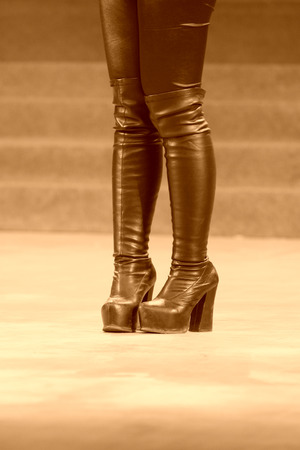 high  heeled: female legs wearing high heeled shoes on the stage Stock Photo
