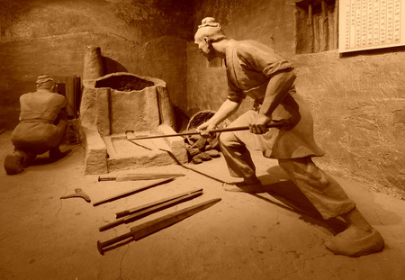smelting: TANGSHAN - NOVEMBER 16: The Han iron smelting sculpture in the kailuan museum, tangshan, hebei province, china.