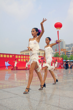 latin dance: LUANNAN COUNTY - AUGUST 10: Latin dance performances in the open air, on august 10, 2014, Luannan County, Hebei Province, China. Editorial