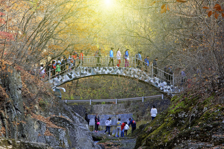 irradiation: BENXI CITY- OCTOBER 12: GuanMenShan scenic spot natural landscape and tourists, on october 12, 2014, Benxi City, Liaoning Province, China