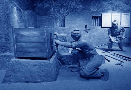 lifelike: TANGSHAN - NOVEMBER 16: The Han iron smelting sculpture in the kailuan museum Editorial