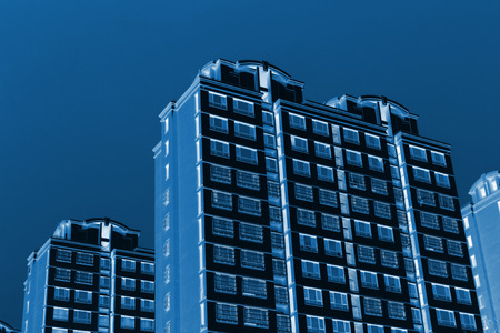 commercial real estate: high rise buildings in the blue sky, closeup of photo