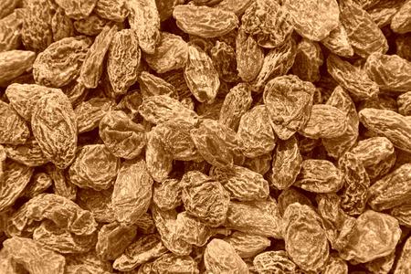 shrinking: pile of raisins, delicious snacks, closeup of photo