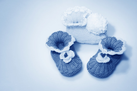 soft sell: wool woven children shoes on white background, closeup of photo Stock Photo