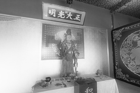 the righteous: LUAN COUNTY - NOVEMBER 10: The word frank and righteous written on the board and buddha figure, November 10, 2013, Luan county, hebei province, China.